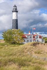 Big Sable (Aaron Springer) Tags: michigan northernmichigan bigsablepointlight ludingtonstatepark stormlight dune dunegrass lighthouse luminous vivid outdoor portraitorientation landscape