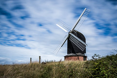 Milling among the clouds (Anthony P26) Tags: architecture brillwindmill buckinghamshire category england external flickrpost landscape places travel travelphotography architecturephotography clouds whiteclouds bluesky grass hill longexposure canon1585mm canon70d canon outdoor landscapephotography motionblur sky