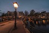 Amsterdam, around the corner (reinaroundtheglobe) Tags: amsterdam amsterdamcanals noordholland nederland holland netherlands longexposure canalhouses canal evening water illuminated streetlights lantern keizersgracht leidsegracht