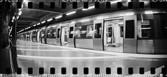 2017-06 - 090SR - DSC_2343 (sarajoelsson) Tags: sprocketrocket blackandwhite bw panorama panoramic sprocketholes digitizedwithdslr toycamera ilford 135 35mm hp5 monochrome plasticlens everydaylife filmphotography filmisnotdead believeinfilm filmshooter film wideangle lomography lomo city urban xtol teamframkallning bnw svartvitt blackwhite stockholm sweden ordinarylife 2017 vardag june summer summertime subway underground tunnelbanan kungsträdgården subwaystation