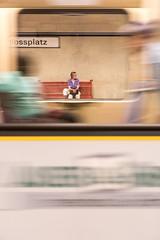 1746 (explored) (.niraw) Tags: stuttgart ubahn ubahnhaltestelleschlossplatz strasenfotografie bank sitzbank frau bahnhof niraw farbe bewegungsunschärfe wartezeit durchblick tasche jacke