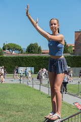 Holding Up The Tower (Ron Scubadiver's Wild Life) Tags: girl woman candid street style nikon 24120 pizza italy outdoor people shorts braids