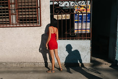 Havana, Cuba (f.d. walker) Tags: americas cuba habana havana lahabana latinamerica northamerica woman women person strange scary mood stranger shadow shadows man men danger dangerous red dress streetphotography street sunlight sun surreal contrast candidphotography candid color colorphotography clothes city colors