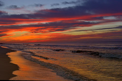 The Sky Bursts into Flames  (024750) (Mike S Perkins) Tags: red orange blue sea ocean surf reflection beach clouds sand sunrise dawn ftmorgan gulfshores gulfofmexico alabama