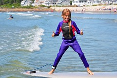 Violet Gives A Thumbs Up As She Surfs All The Way To The Sand (Joe Shlabotnik) Tags: justviolet july2017 higginsbeach violet surfing 2017 maine thumbsup ocean beach afsdxvrnikkor55300mm4556ged