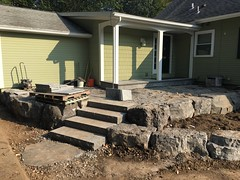 Tilie in the porch, rock wall in place (deroller) Tags: landscaping hardscaping landscape rocks boulders dolomite limestone plantings lighting volt cumberland bay patio front yard remake