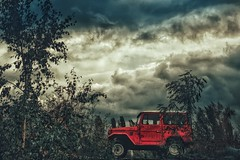 The red one... (hobbit68) Tags: auto car red rot sky himmel clouds wolken tree baum busch