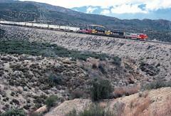 AT&SF B40-8W 528, SD45-2u 5803, GP60 4031, and GP60M 117 in Cajon Pass, CA on March 6, 1994. (railfan 44) Tags: atsf santafe