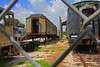 FGC #100 & a Railcar being restored in the Museum Yard behind the Fence at Willow (gg1electrice60) Tags: fgcnumber100 floridagulfcoastno100 44toncentercabswitcherfgc100 centercabswitcher ge44tonlocomotive ge generalelectric fgcx100 reportingmarksfgcx100 donatedbyusnavy1995 jacksonvillenavalairstation parrish willow willowroad willowrd manateecounty usroute301 us301 formerusnavy6500345 usn6500345 diesellocomotive dieselengine builtbyge passengercars railcars rollingstock floridarailroadmuseum frm frrm gulfcoastrailroadmuseum gcrm gcrrm unitedstates usa us america northofparrish railroad railroadyard railroadstation railroaddepot railroadmuseum railroadtracks rrtrack rr rrdepot rrmuseum rrtracks rryard railyard railcar fence chainlinkfence museum rrstation touristrailroad touristexcursions tourists railfanexcursions excursions train trainstation trainmuseum trainrides displays ondisplay clerestoryroof rustyandcrusty rustycrusty clerestorycoachusstock florida goldcoastrailroadmuseum