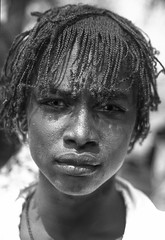 Ethiopia : Gambella region , B&W portraits #12 (foto_morgana) Tags: africa afrika afrique afrotexturedhair analogphotography analogefotografie boy caractère character childhood editorialonly ethiopia ethiopië ethnic ethnicity ethnie etnia etniciteit jeugd jeune jeunesse jong juventud karakter kodakportra160vc kroeshaar nikoncoolscan nomodelrelease nuer outdoor people persoonlijkheid photographieanalogue portrait portraitprostudiomax portret sweat teenager travelexperience vuescan young youth