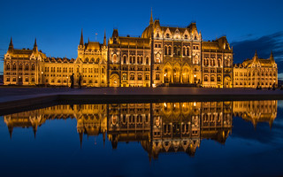 The Parliament in Budapest reflected in the water at blue hour