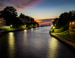 Pine River Channel (T P Mann Photography) Tags: river lake sun sunset sundown skyline pier lighthouse long exposure night dusk color cloud lamp posts clouds canon tamron serene evenoing evening low light reflections walk side walkway