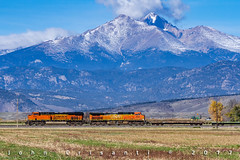 Empty Military Train and High Peaks (Colorado & Southern) Tags: bnsfrailway gees44dc gec449w militarytrain flatcar trains train railfanning railroad railfan railway railroads rockymountains railroading rail rr railroadtrack colorado coloradorailroads coloradotrains