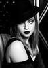 In the mood for noir (Giulia Valente) Tags: portrait portraiture ritratto woman beauty beautiful hat lips noir dark bw blackwhite darkportrait vintage monochrome mono people one confident alone light shadow