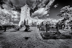 Ghostly churchyard (David Feuerhelm) Tags: blackandwhite noiretblanc bw monochrome schwarzundblanc contrast outdoors wideangle infrared ir ethereal church churchyard graveyard tombs graves tombstones gravestones sky clouds trees buildings tower windows clock silverefex nikon d90 nikond90 sigma1020mm