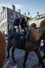 Riding of the Marches 2017-58 (Philip Gillespie) Tags: edinburgh 2017 riding marches horses people men woman girl boy family canon eos 5dsr royal mile scotland saddles styrups glasses helmets ribbons bridles sun sunshine summer warm afternoon equestrian equine hair rode crowds gathering teeth tongues face legs hands arms arches eyes mouth pony gymnastics acrobatics tartan band tuba drums brass silver playing music marching sheet trombone tails harness animal