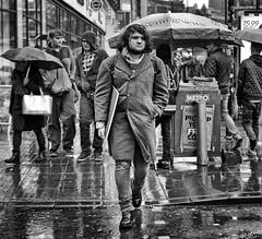 Rainy days (Mick Steff) Tags: rain days shower single male urban street manchester piccadilly black white mono monochrome people