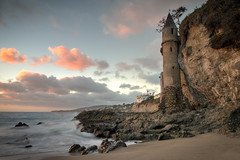 Pirate Tower at Victoria Beach (Roving Vagabond) Tags: sunset laguna beach victoria victoriabeach lagunabeach piratetower sand ocean cloud clouds landscape seascape rock water sea pacific california ca usa westcoast sky pink blue explore longexposure latour la tour socal tower bluff