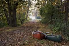 Two canoes.... (Joe Hengel) Tags: elizabethtownshippa two canoes pennsylvania pa fall fallcolors canoe pair couple woods forest trees trail path walkingpath lakeside speedwellforgelake twocanoes morning morninglight goodmorning
