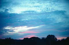A Touch of Light (Past Our Means) Tags: cinestill film canon ae1 analog analogue adventures autumn twilight sunset travel 800t hiking mountain 35mm 28mm istillshootfilm indiefilm indie tree clouds red connecticut new england filmisnotdead filmphotography blue pink explore