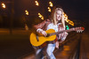 Positive Smiling Caucasian Blond Woman Playing the Guitar Outdoors at Dusk. Mixture of Flash and Halogen Light Used. (DmitryMorgan) Tags: 1 2027years 20s activity adult beautiful blond blondy casual caucasian city emotions enjoying expressive feelings female feminine flashlight girl guitar halogen happiness havingfun leatherjacket musician nightshot one outdoors outside performing playing rails red romantic sensual sensuality singing smiling springtime streetlife talented twenties woman young