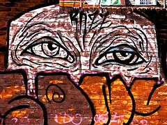 You Looking At Me? (Steve Taylor (Photography)) Tags: eyes wrinkles razz art digital graffiti streetart tag scaffolding scaffold wall orange black white yellow brown contrast brick uk gb england greatbritain unitedkingdom london silhouette