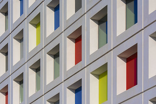 White facade with colored windows