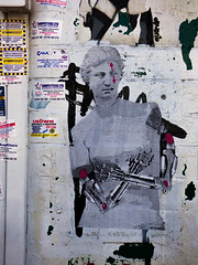 Cross My Heart (Steve Taylor (Photography)) Tags: crossmyheart bionic venusdemilo modernart art graffiti pasteup wheatup wheatpaste streetart sticker black grey white yellow red woman uk gb england arms mechanical arrow promesto