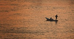 In Search For Luck ... (Hazem Hafez) Tags: water nile river boat fishing duet sunset minimalism