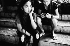 Two Friends Waiting (Meljoe San Diego) Tags: meljoesandiego fuji fujifilm x100f streetphotography streetlife candid people monochrome philippines