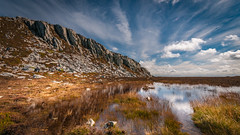 Holyhead mountain... (Einir Wyn Leigh) Tags: landscape mountain bluesky clouds puddle water foliage plants light walking anglesey wales cymru reflection orange golld autumn outside colorful nature trail coastal island rock crag