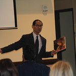 Dr. Kang-Na gives a students a book to pass around during his talk.