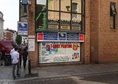 High wordiness of Liverpool businesses. (Tim Kiser) Tags: 2017 20170807 august august2017 boldstreet boldandheathfield desktopprintliverpool england greatbritain heathfieldstreet heathfieldandbold img0401 liverpool liverpoolengland liverpoolcitycenter liverpoolcitycentre lostart lostartshop merseyside northwestengland uk unitedkingdom arrows businesssigns cashforgold citycenter citycentre coveredwindow decalsigns downtown embroidery formerskateshop fullcolour keycutting listofbrands listofproducts listofservices mugprinting northernengland northwesternengland pedestrians people piecesofpaper printshop printingbusiness printingindustry screenprinting shopsigns signs skateshop smallbusinesses streetcorner tshirtprinting windowdecals windowsigns windows txtchg