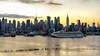 City Cruising (Gary Walters) Tags: glow manhattan empirestatebuilding landscape newyork midtown nyc zeiss sonya7r buildings sony sunrise skyline cityscape sel55f18z