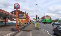 An English carwash dominates a sidewalk. (Tim Kiser) Tags: 2017 20170810 a665 a665road august august2017 britishlandscape britishstreetscape cheethamhill cheethamhillroad cheethamhillstreetscape dmxtyres england englandlandscape englishlandscape englishstreetscape greatbritain greatbritainlandscape img5520 manchester manchesterengland manchesterlandscape manchesterstreetscape northwestengland thebiggreenparcelmachine tuffnells tuffnellsparcelsexpress uk ukno1 ukno1carwash ukno1handcarwash unitedkingdom banners canopy carwash carwashsigns cars deliverytruck handcarwash hourssign lampposts landscape man mostlycloudy northernengland northwesternengland paved pavement pedestrian person redlight sidewalk sidewalklandscape stoplight streetlights streetscape traffic trafficlight trafficsignal urbanlandscape walkingman wewashanycar