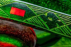 Cannibal Fork Detail (melmark44) Tags: inexplore explore longpig macromondays souvenir cannibalfork yummy longpork lightpainting longexposure hmm happymacromonday bokeh green red brown colors colorful dof depthoffield pattern texture