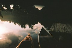Bob's lake (The_Last_Magnus) Tags: film analog analogue pentax 35mm sunset canoe boats reflection