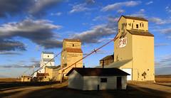Grain Elevators. Mossleigh Alberta. (Bernard Spragg) Tags: mossleigh grain elevators alberta three lumix fz1000 road sky architecture grainelevatorsalberta bestflickrphotography