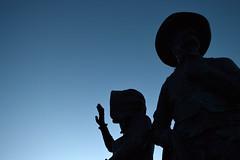 Settlers Silhouettes (Sotosoroto) Tags: prescott arizona veteransmemorialisland earlysettlers statue