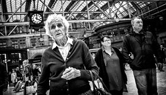 Time takes it's toll on us all. (Mister G.C.) Tags: blackandwhite bw image streetshot streetphotography candid people photograph old elderly lady woman female wrinkles aged trainstation glasgowcentral monochrome urban town city zonefocus zonefocusing snapfocus ricoh ricohgr pointshoot mistergc schwarzweiss strassenfotografie scotland glasgow britain greatbritain gb british uk unitedkingdom europe