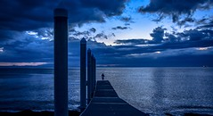 At the end of the dock (Christie : Colour & Light Collection) Tags: dock pier moody clouds cloudy boatramp piling usa canada pilings nikon internationalwaters international