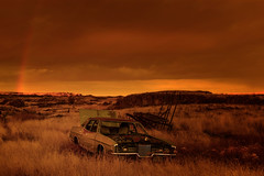 Marmalade Skies, With Rainbow (garshna) Tags: ford abandoned automobile car sunset rainbow grasses canyon clouds sky