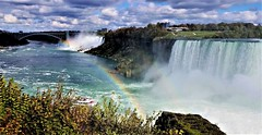 Rainbow Dreams Niagara Falls (moonjazz) Tags: rainbow waterfall niagarafalls panorama photography nature canada color spectacular amazing wonder vista travel usa river weather power view horseshoe american falls mist geography earthscience mighty flckr moonjazz favorite newyork ontario