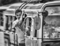 Standing Room Only #2 (FotoGrazio) Tags: asian bohol filipino man philippines pinoy streetphotography tagbilaran visayas waynegrazio waynesgrazio blackandwhite composition dangerous fotograzio hangon holdtight male motion movement people standingroomonly stayingcool streetportrait streetscene taxi transportation van youngman