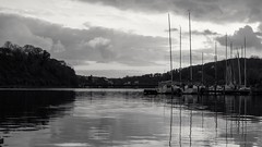 Masts (frankdorgathen) Tags: monochrome blackandwhite lake reservoir baldeneysee essen ruhrgebiet landscape sunset water reflection mast ship autumn fall nature cloud