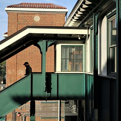 morning departure (jim_ATL) Tags: beaux arts railroad station stairs man silhouette green iron girder red brick poughkeepsie new york explored