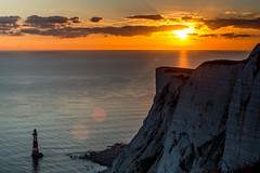 Beachy Head Sunset (Aleem Yousaf) Tags: birling gap eastbourn beachy head chalk cliffs seve sisters english channel sun flare sunset lighthouse cornish granite trinityhouse nikon d800 70200mm photography east sussex seasideholywel waves landscape photowalk lee graduated neutral densoty filter england clouds sky reflection golden hour