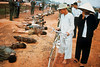 Vietnam War 1968 - Onlookers Walking Past Row of VC Corpses (manhhai) Tags: adults asia asianhistoricalevent asians battle bicycle burned casualty clothing corpse dead death disasteranddestruction dismembered females group historicevent horror looking males men middleaged northamericanhistoricalevent people southeastasia southeastasians traditionalclothing unitedstateshistoricalevent vehicle victim vietnam vietnamwar19591975 vietnamese vietnamesehistoricalevent war warvictim women
