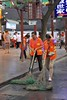 Street Cleaners (oxfordblues84) Tags: peoplesrepublicofchina china xian xianchina oat overseasadventuretravel touristattraction muslimquarter huipeople chinese streetcleaners sweeping streetsweepers streetsweeper man woman broom people chinesestreetsweepers blueflagstone