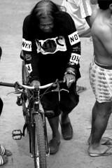 _MG_9875 (Caesar Ramos) Tags: black white bnw human interest portrait old man cigarettes cycling bicycle rural slum village street wear grown hair cannon eos 7d